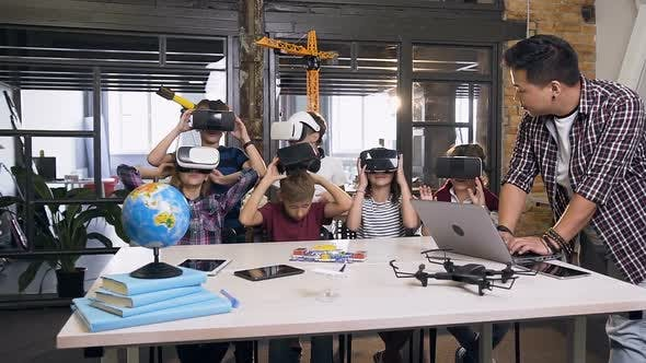 Thumbnail for Group of Six Cheerful Young Caucasian Students Wearing VR