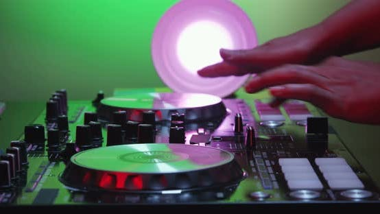 Thumbnail for DJ Adjusting The Knobs And Mixing 11B