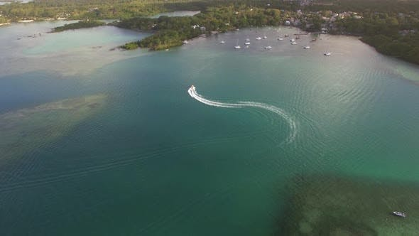 Thumbnail for Flying Over Motor Boat Sailing in Bay, Mauritius Island