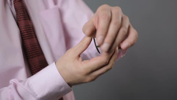 Thumbnail for Business Person Putting on Wrist-Watch and Checking Time, Close Up Shot