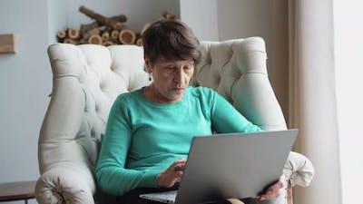 Elderly Woman Learn Work on Laptop