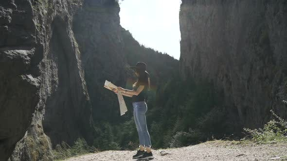 Beautiful Women with Touristic Map in Trigrad, Shiroka Laka, Bulgaria. Happy Girl Enjoy Bulgarian