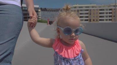 Fashionable little girl in sunglasses