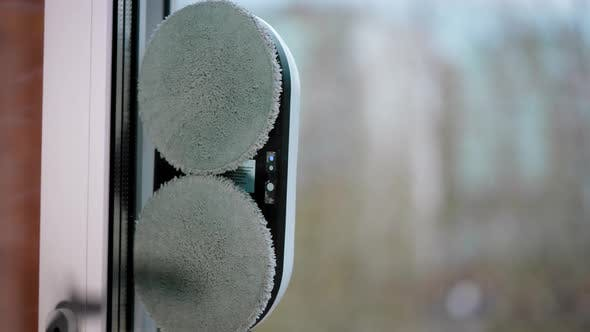 A Modern Automatic Robot Cleans the Window