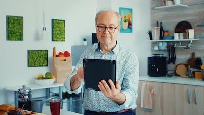 Older Man Holding Tablet Pc