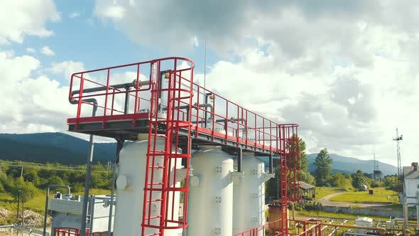 Thumbnail for Aerial View Gas Production Station. Metal Construction with Valves on the Pipes. Distribution and