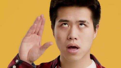 Bored Japanese Guy Gesturing Blah Blah Gesture Yellow Background