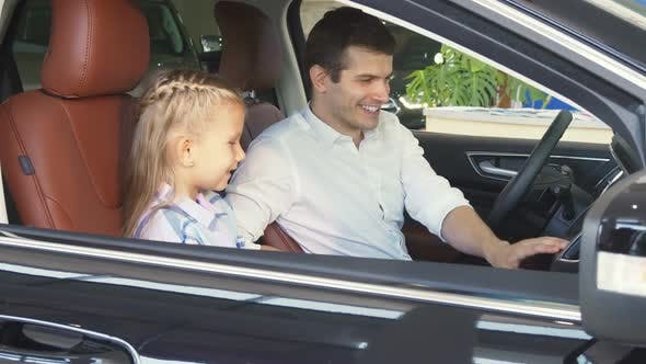Thumbnail for Happy Father Tells His Daughter About the Function of the Car