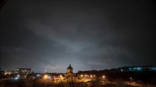 Beautiful time lapse: massive clouds floating night city sky.