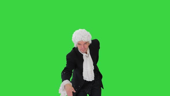 Thumbnail for Man in Old-fashioned Laced Frock Coat and White Wig Making a Bow Looking at Camera on a Green Screen