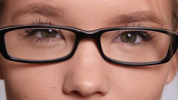Extreme closeup of young woman with glasses