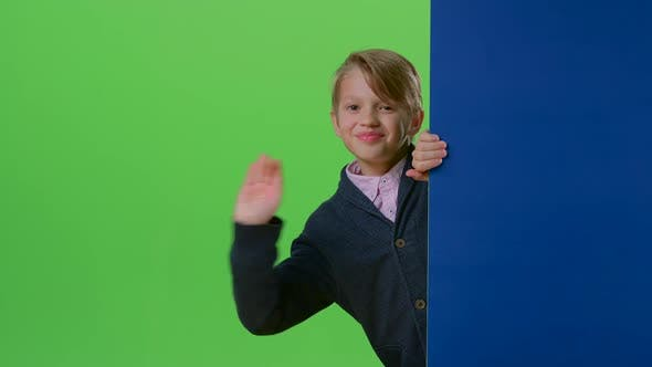 Thumbnail for Teen Comes Out From Behind the Walls Waving and Calling To Yourself on a Green Screen