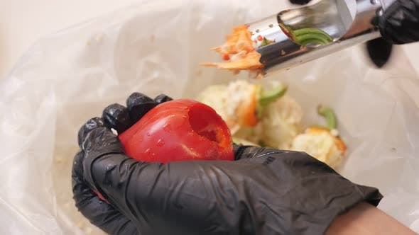 Thumbnail for Close-up of separating the stem from paprika with kitchen tool 4K 2160p 30fps UltraHD footage - Wint