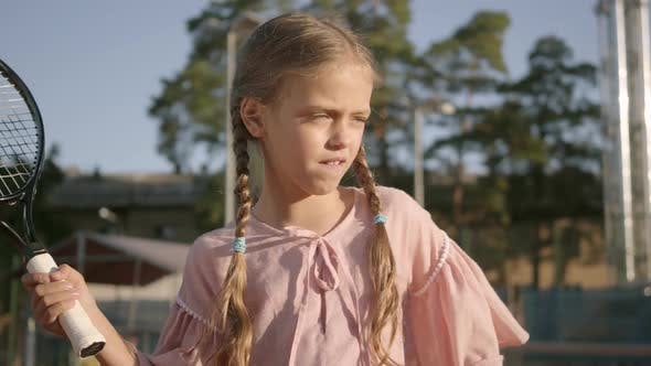Thumbnail for Portrait Adorable Funny Girl with Two Pigtails Playing Tennis Outdoors