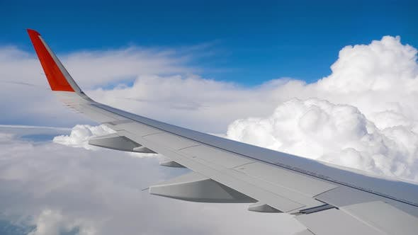 Cover Image for Wing of Airplane on Sky and Cloud on Moving