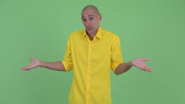 Thumbnail for Happy Confused Bald Businessman Shrugging Shoulders