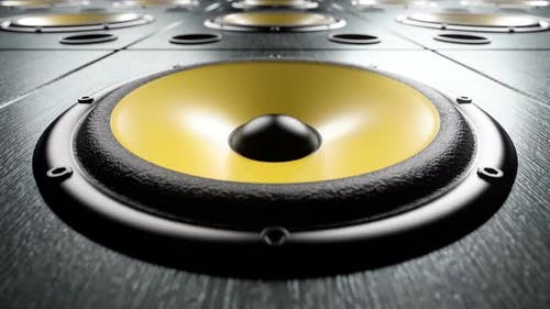 Moving over Audio Speakers with Yellow Membranes Playing Rhythmic Music