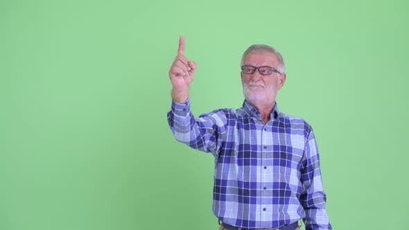 Thumbnail for Stressed Senior Bearded Hipster Man Pointing Up and Giving Thumbs Down