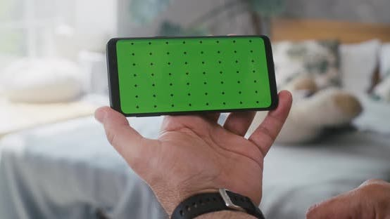 Thumbnail for Man Using a Smartphone