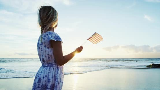 Thumbnail for Young Girl with American Flag on Beach