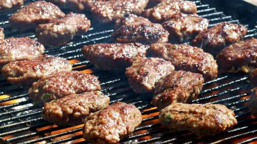 Meatball On Barbecue And Smoke
