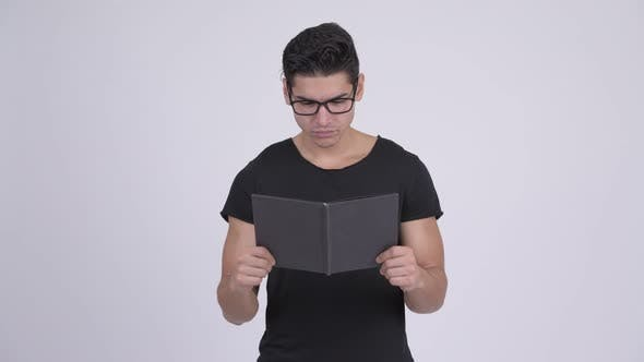 Thumbnail for Young Multi-ethnic Nerd Man Covering Face with Book