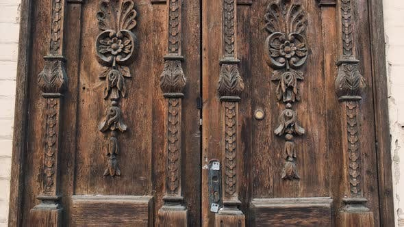 Thumbnail for An Old Wooden Door in To a Beautiful Ancient Place Tilt-up Shot. Wood Texture Doors