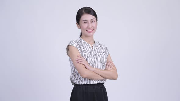 Cover Image for Happy Beautiful Asian Businesswoman Smiling with Arms Crossed