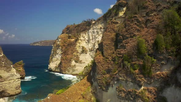 Thumbnail for Aerial View Rocky Shore and Ocean with Waves and Rocky Cliffon Nusa Penida Island, Bali in Indonesia