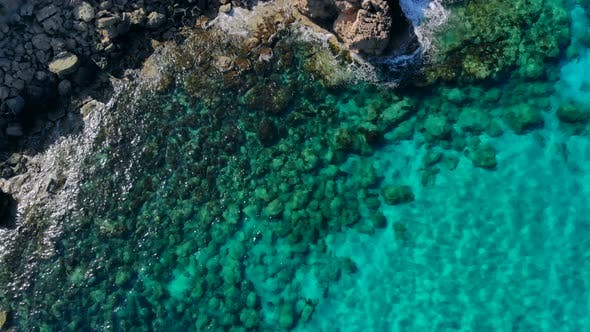 Aerial View of Crystal Clear Blue Water in Quiet Lagoon on Shore of Cyprus