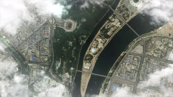 Zooming in from earth orbit to Pyongyang North Korea in East Asia