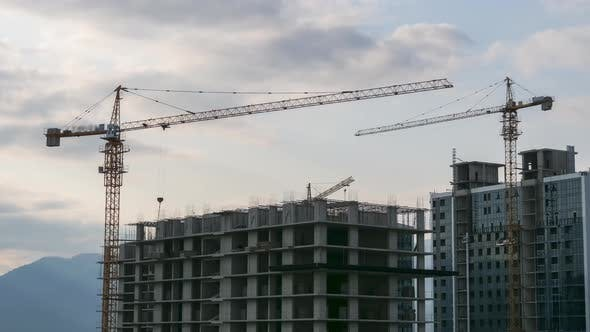 Thumbnail for Building Construction. Timelapse. Tower Crane on a Construction Site Lifts a Load at High-rise
