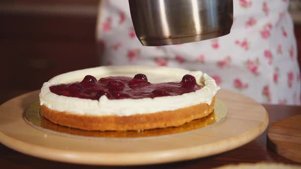 Cooks Hands, Who Puts the Sweet Stuffing on the Cake, the Woman Puts the Fruit