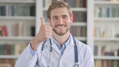 Portrait of Doctor Showing Thumbs Up Sign