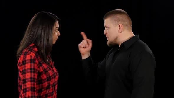 Angry Man Shouting and Shaking Woman. Black. Close Up