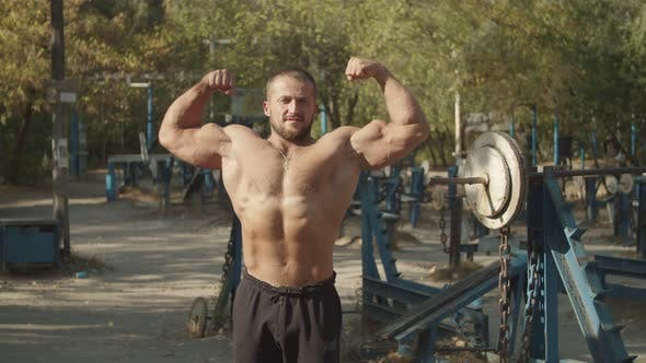 Shirtless Bodybuilder Doing Double Biceps Pose