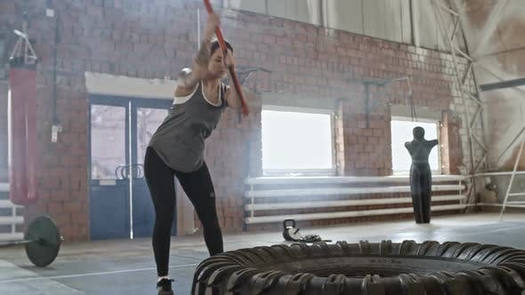 Thumbnail for Woman Doing Sledgehammer Training