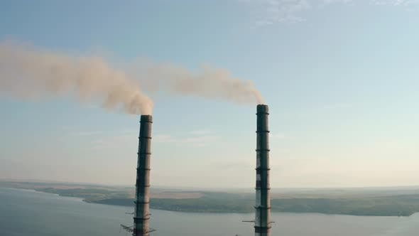 Thumbnail for Aerial Drone View of High Chimney Two Pipes with Grey Smoke From Coal Power Plant. Close Up V2