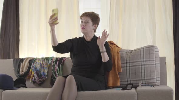 Thumbnail for Portrait of Beautiful Caucasian Senior Lady Recording Selfie Video on Her Smartphone. Mature Female