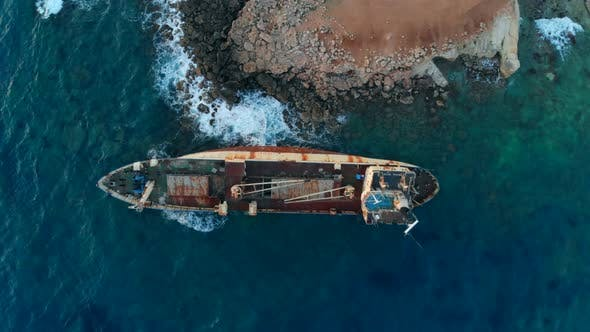 Abandoned Boat Stranded on Shore of Mediterranean Sea, Top View