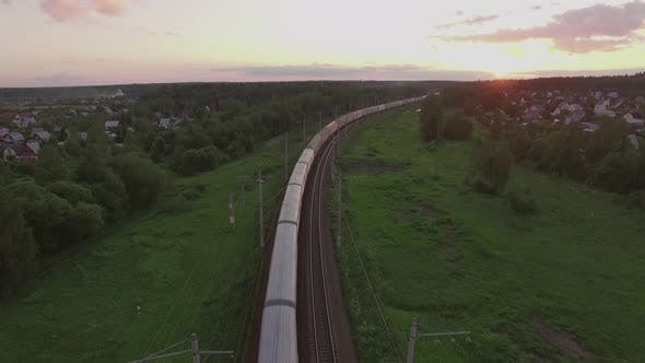 Thumbnail for Cargo Train Crossing Countryside at Sunset, Russia