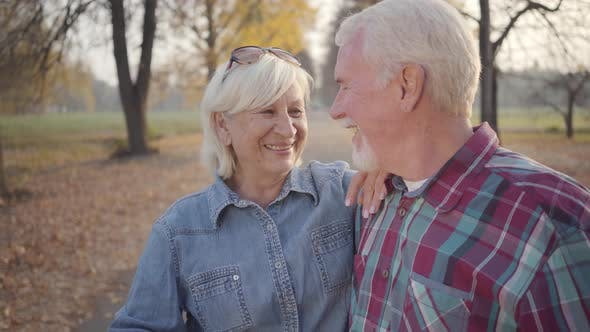 Thumbnail for Happy Caucasian Mature Family Looking at Each Other and Smiling. Senior European Couple