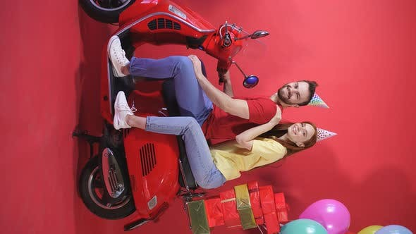 Cheerful Young Couple Man Woman Scooter Deliver Balloons Gifts Holiday Birthday