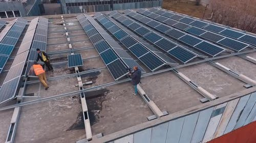 Solar photovoltaic panels. Aerial view of photovoltaic power plant on roof