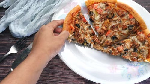Man Hand Taking Slice of Cheese Pizza From a Plate