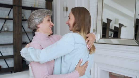 Thumbnail for Old Mother and Mature Daughter Hugging at Home. Happy Senior Mother and Adult Daughter Embracing