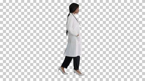 Sad African american female doctor walking, Alpha Channel