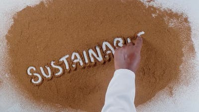 Hand Writes On Soil  Sustainable