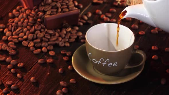 Thumbnail for Espresso in Small Cup on a Saucer on Wooden Table