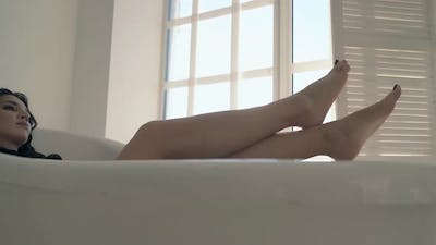 Motion Along Stylish Bath with Attractive Woman Inside